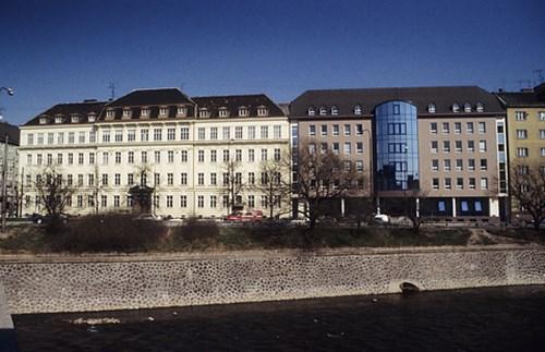 Poříčí 7 s dostavbou budov Poříčí 9-11, 90. léta 20. stol.