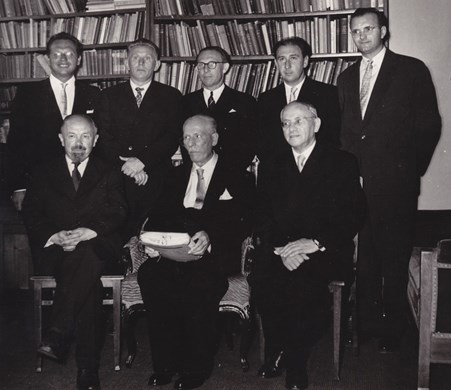 Celebration of prof. Novotný's 80th birthday. Standing from the left: Bartoněk, Janáček, Pelikán, Hošek, and Češka; sitting from the left: Ludvíkovský, Novotný and Hejzlar. 1965. Source: Archive of MU.