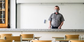 A teacher stays in the classroom, with cameras in place of students